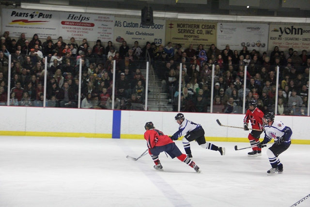 Great Hockey for the Fans with Fast Moving Action Compliments of Bryon Houlgrave, The Des Moines Register