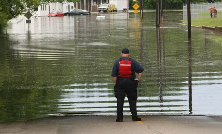 MCFD Fire Fighter Looking Out at 2008 Flood Waters